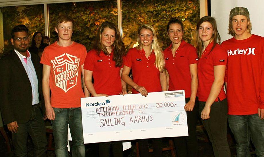Med en pæn klat penge i hånden kan sejlerne få råd til fokusere på deres sport. Foto: Sailing Aarhus